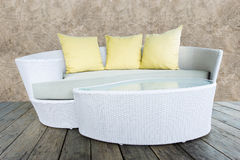 Sofa furniture weave bamboo stick chair with yellow pillows Royalty Free Stock Photos