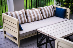 Sofa in garden Stock Image