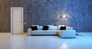 Sofa gegen eine Betonmauer stockfotografie