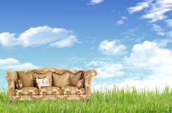 Sofa on the grass field Royalty Free Stock Photography