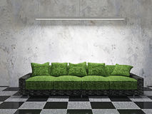 Sofa with green cushions. Near the wall Stock Photos