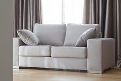 Sofa gris Photographie stock
