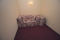 Sofa in the hallway of the hotel economy class Stock Photo
