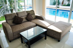Sofa in home. Near swimming pool Royalty Free Stock Image