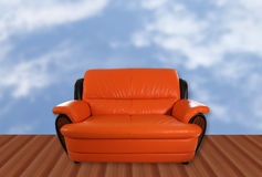 Sofa. Image of orange sofa and clound background Stock Image
