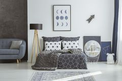 Free Sofa In Navy Blue Bedroom Stock Photography - 112677702