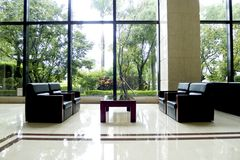 Sofa indoors. Beautiful black modern sofa indoors in public lobby of a building Stock Images