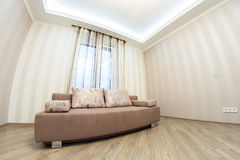 Sofa in the interior, a large spacious room. Modern interior room with nice furniture inside. Photo shot on fisheye lens Stock Photography