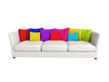 Sofa - Interiors. Sofa with white and colored cushions / pillows Stock Image