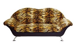 A sofa isolated on a white background. A sofa tiger fur isolated on a white background Royalty Free Stock Photo