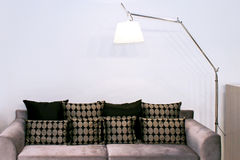 Sofa and lamp Stock Photos