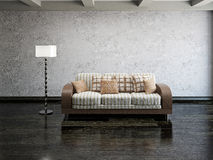 Sofa and lamp. Near the cement wall Royalty Free Stock Photos
