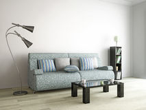 Sofa, lamp and table near the wall Stock Photo