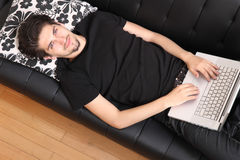 On the Sofa with a Laptop Stock Photography