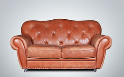 Sofa. Large and comfortable brown leather sofa in classic style Stock Photos
