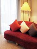 Sofa in a living room. Red sofa in living room with lamp next to window Royalty Free Stock Images
