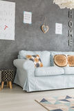 Sofa in living room. Blue sofa in modern grey living room Stock Image