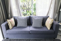 Sofa in living room with nature view outside. Royalty Free Stock Image