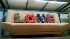 Sofa with love cushions Stock Photography