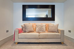 Sofa and mirror Royalty Free Stock Photos