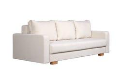 Sofa mit weißer Gewebepolsterung (Seitenansicht) Stockbilder