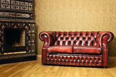 Sofa Near The Fireplace Royalty Free Stock Image