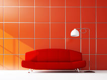 Sofa near the red wall Royalty Free Stock Images