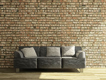 Sofa near the wall Stock Photography