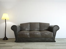 Sofa near the wall Royalty Free Stock Photos
