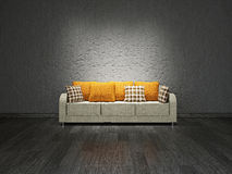 Sofa near the wall. Sofa with pillows near the concrete wall Royalty Free Stock Photos
