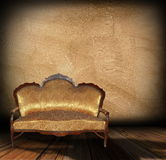 Sofa over architectural indoor backdrop Stock Image