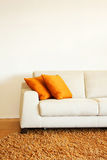Sofa part. Part of white leather sofa with pillows Royalty Free Stock Photography