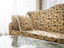 Sofa with pillows with floral fabric classic style Stock Photo