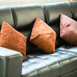 Sofa and pillows interior. Inside guest room royalty free stock photo