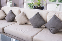 Sofa and pillows in living room Stock Image