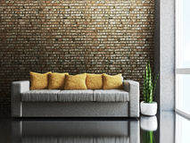 Sofa with pillows. Near a brick wall Royalty Free Stock Images