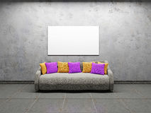 Sofa with pillows. Near the concrete wall Royalty Free Stock Photo