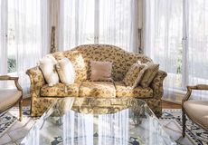 Sofa with pillows table set with floral fabric classic style Stock Photo