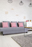 Sofa with red pillows stock photo