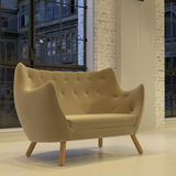 Sofa rond moderne de velours dans le grenier photos stock