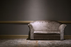 Sofa in the room. Leather sofa in the room with light Stock Image