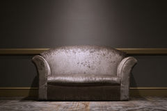 Sofa in the room. Leather sofa in the room with light Royalty Free Stock Image