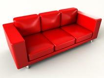 Sofa rouge Photographie stock