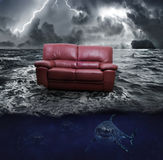 A sofa on the sea Stock Images