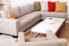 Sofa set with colored cushions Stock Photography
