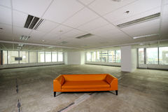 Sofa in space room. Orange sofa in space room Royalty Free Stock Photography