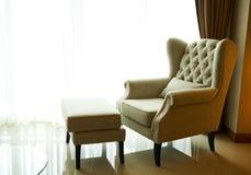 Sofa and stool bright light from window. Stock image Royalty Free Stock Photos
