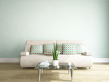 Sofa and table near the wall Stock Photo