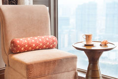 Sofa and tea table by the window Stock Photo
