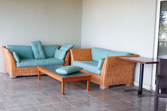 Sofa on the terrace with a coffee table Stock Photography